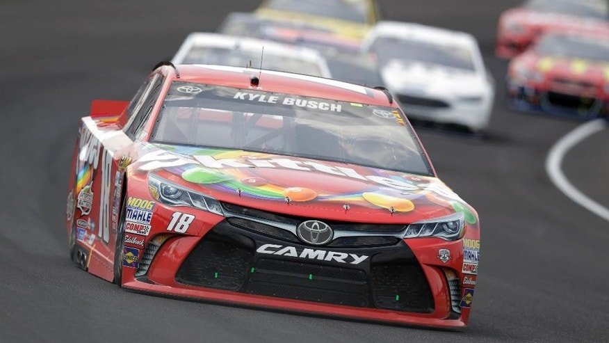 Kyle Busch (18) drives through the first turn during the Brickyard 400 NASCAR Sprint Cup auto race at Indianapolis Motor Speedway in Indianapolis, Sunday, July 24, 2016. (AP Photo/Michael Conroy)