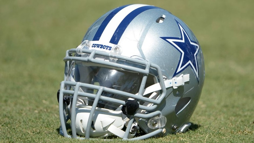 Jul 31, 2014; Oxnard, CA, USA; Dallas Cowboys helmet at training camp at the River Ridge Fields. Mandatory Credit: Kirby Lee-USA TODAY Sports