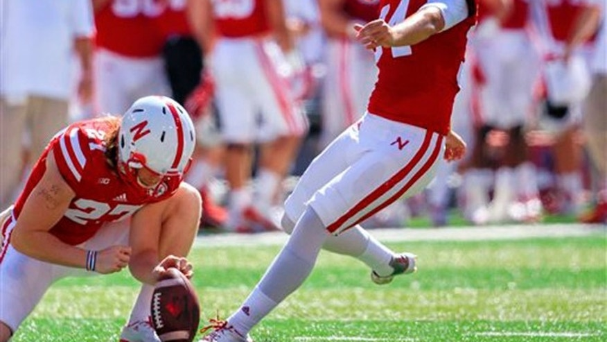 In this Sept. 26, 2015, file photo, Nebraska kicker Drew Brown (34) kicks a field goal with Sam Foltz, left, holding during the first half of an NCAA college football game against Southern Miss in Lincoln, Neb.