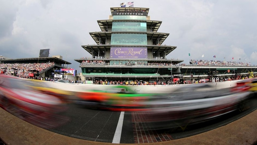 INDIANAPOLIS, IN - JULY 26: Cars race by during the NASCAR Sprint Cup Series Crown Royal Presents the Jeff Kyle 400 at the Brickyard at Indianapolis Motor Speedway on July 26, 2015 in Indianapolis, Indiana. (Photo by Brian Lawdermilk/Getty Images)