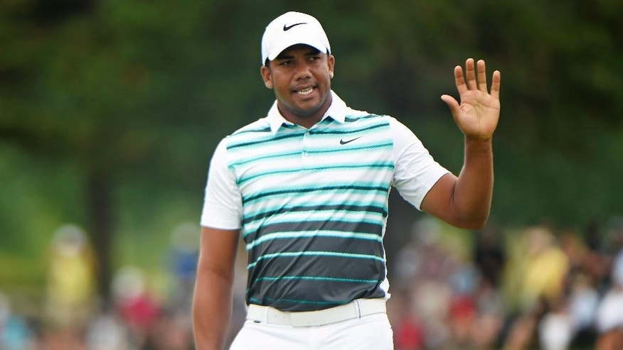 Jhonattan Vegas, of Venezuela, acknowledges the crowd on the 18th green during the final round at the Canadian Open golf tournament in Oakville, Ontario, Sunday, July 24, 2016. (Nathan Denette/The Canadian Press via AP)