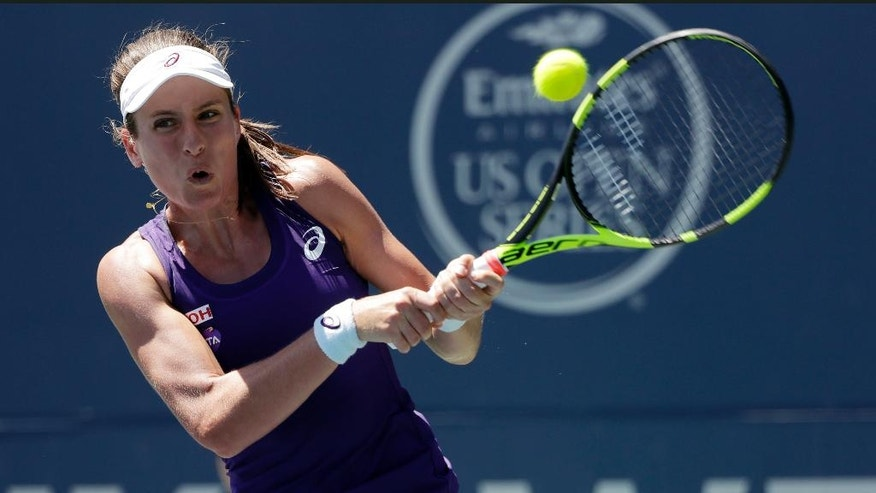 Johanna Konta, of Britain, returns to Venus Williams, of the United States, during the final in the Bank of the West Classic tennis tournament Sunday, July 24, 2016, in Stanford, Calif. (AP Photo/Marcio Jose Sanchez)