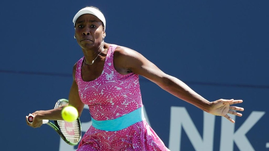 Venus Williams, of the United States, returns to Johanna Konta, of Britain, during the final in the Bank of the West Classic tennis tournament Sunday, July 24, 2016, in Stanford, Calif. (AP Photo/Marcio Jose Sanchez)