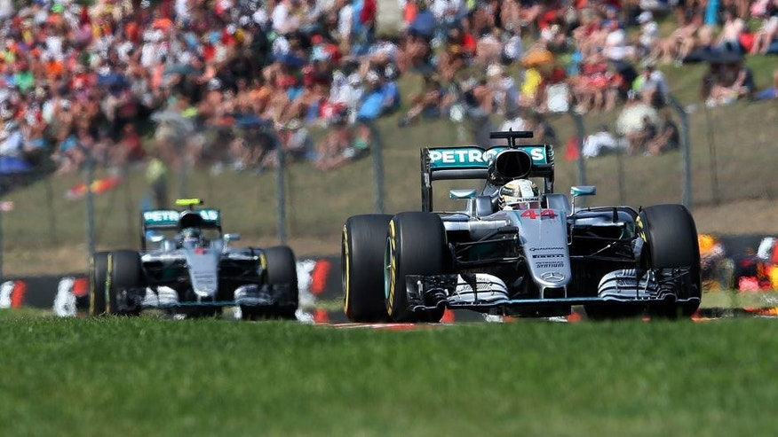 Mercedes driver Lewis Hamilton of Britain leads ahead of Mercedes driver Nico Rosberg of Germany during the Hungarian Formula One Grand Prix at the Hungaroring racetrack near Budapest, Hungary, Sunday, July 24, 2016.(AP Photo/Luca Bruno)