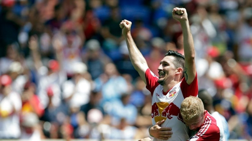 Jul 24, 2016; Harrison, NJ, USA; New York Red Bulls midfielder Sacha Kljestan (16) celebrates scoring a penalty kick goal with forward Mike Grella (13)against the New York City FC during the first half at Red Bull Arena. Mandatory Credit: Adam Hunger-USA TODAY Sports