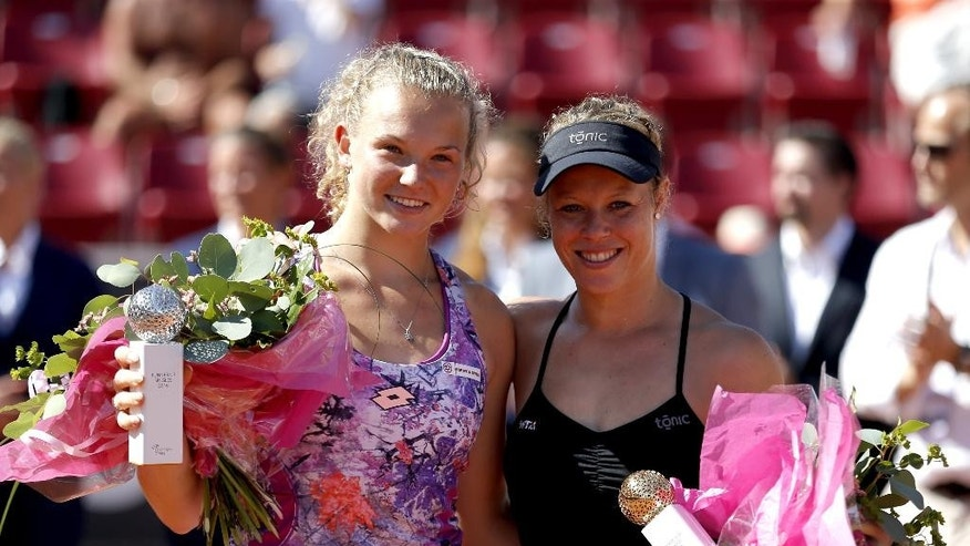 Germany's Laura Siegemund, right, poses with runner up  Czech Republic's  Katerina Siniakova, after winning the Swedish Open final tennis match, in Bastad, Sweden, Sunday, July 24, 2016. (Adam Ihse /TT News Agency via AP)