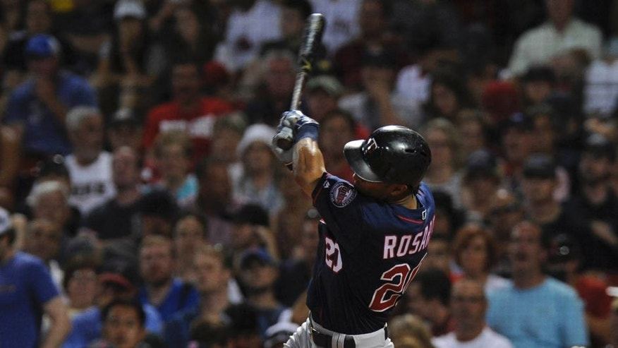 Jul 23, 2016; Boston, MA, USA; Minnesota Twins left fielder Eddie Rosario (20) hits an RBI single during the seventh inning against the Boston Red Sox at Fenway Park. Mandatory Credit: Bob DeChiara-USA TODAY Sports