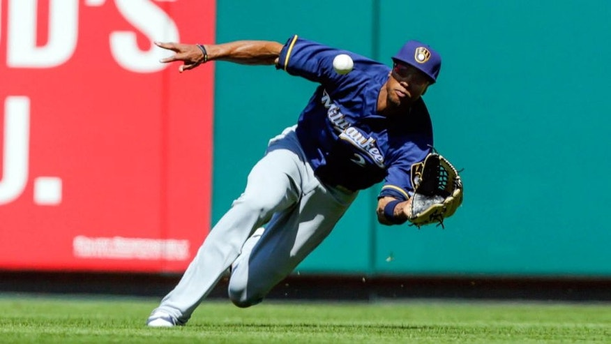 Thursday, April 14: The Milwaukee Brewers' Keon Broxton makes a sliding catch on a line drive hit by the St. Louis Cardinals' Kolten Wong.