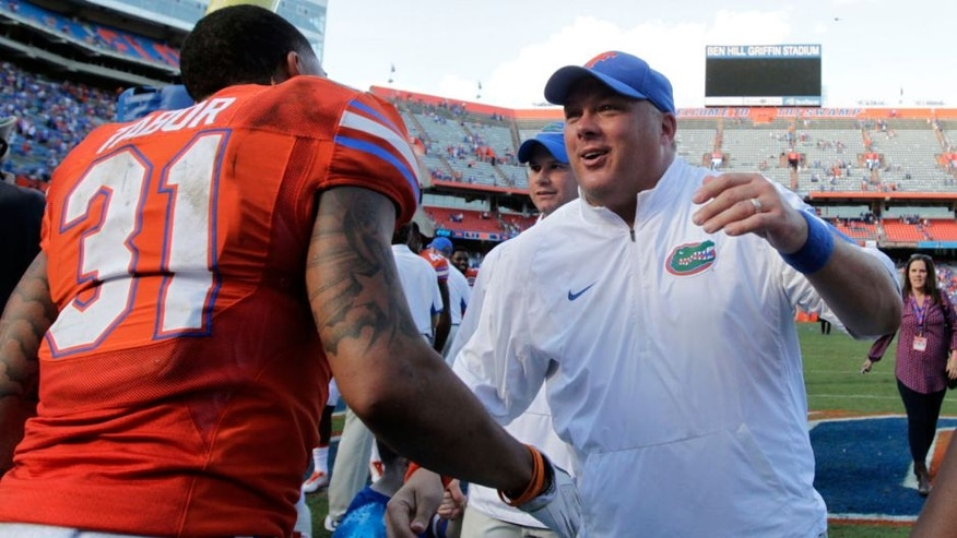 Nov 7, 2015; Gainesville, FL, USA; Florida Gators defensive back Jalen Tabor (31) and defensive coordinator Geoff Collins congratulate each other as they beat Vanderbilt Commodores at Ben Hill Griffin Stadium. Florida Gators defeated the Vanderbilt Commodores 9-7. Mandatory Credit: Kim Klement-USA TODAY Sports