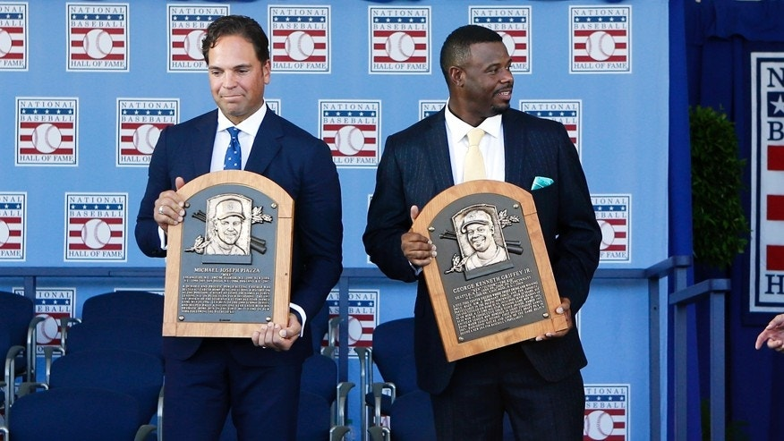 July 24, 2016: National Baseball Hall of Fame inductees Mike Piazza, left, and Ken Griffey Jr. hold their plaques for photos after the induction ceremony at Clark Sports Center in Cooperstown, N.Y.