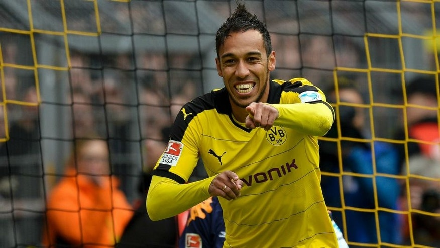 Dortmund's Gabonese striker Pierre-Emerick Aubameyang celebrates scoring the 4-0 goal during the German first division Bundesliga football match Borussia Dortmund vs VfL Wolfsburg, in Dortmund, western Germany, on April 30, 2016. / AFP / Sascha SCH������RMANN / RESTRICTIONS: DURING MATCH TIME: DFL RULES TO LIMIT THE ONLINE USAGE TO 15 PICTURES PER MATCH AND FORBID IMAGE SEQUENCES TO SIMULATE VIDEO. == RESTRICTED TO EDITORIAL USE == FOR FURTHER QUERIES PLEASE CONTACT DFL DIRECTLY AT + 49 69 650050 (Photo credit should read SASCHA SCHURMANN/AFP/Getty Images)