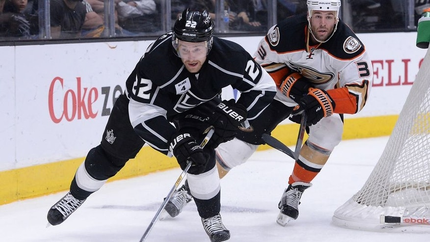 Jan 17, 2015; Los Angeles, CA, USA; Anaheim Ducks defenseman Clayton Stoner (3) and Los Angeles Kings center Trevor Lewis (22) chase down the puck in the second period of the game at Staples Center. Mandatory Credit: Jayne Kamin-Oncea-USA TODAY Sports