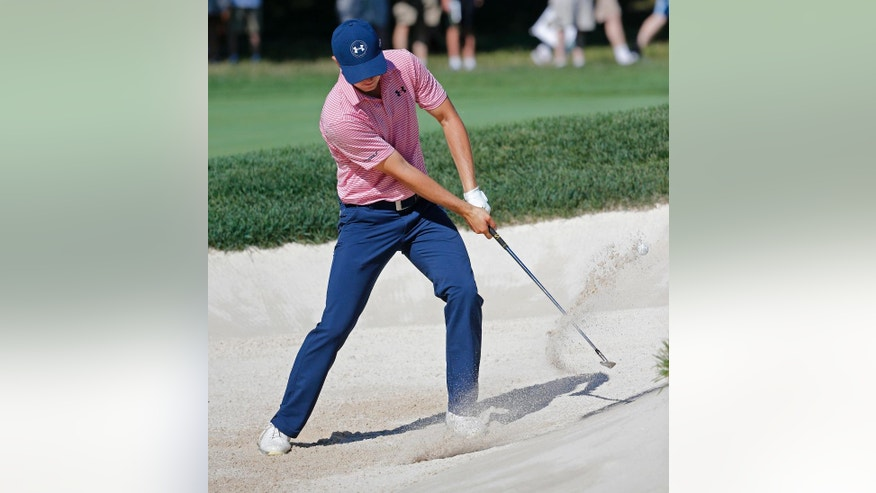 Jordan Spieth hits from a sand trap on third hole during a practice round for the PGA Championship golf tournament at Baltusrol Golf Club in Springfield, N.J., Tuesday, July 26, 2016. (AP Photo/Mike Groll)