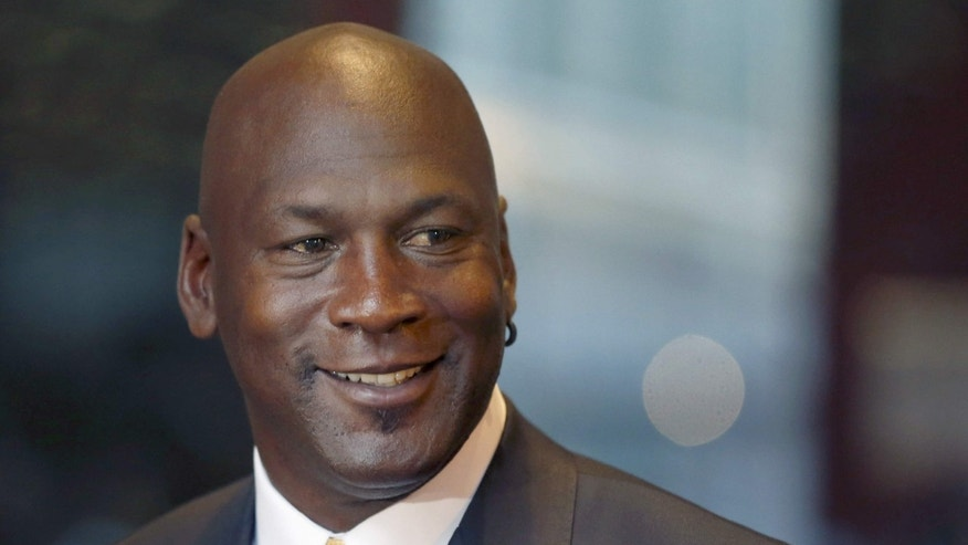 FILE - In this Aug. 21, 2015, file photo, former NBA star and current owner of the Charlotte Hornets, Michael Jordan, smiles at reporters in Chicago.