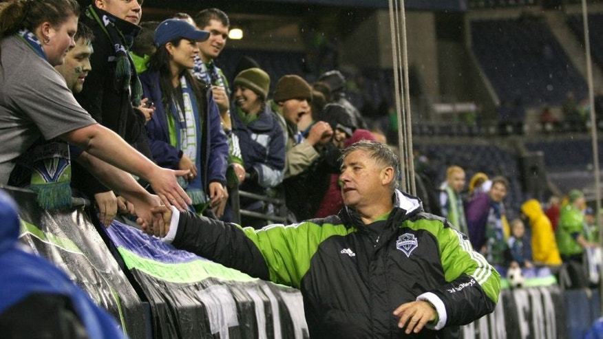 SEATTLE - MARCH 25: Head coach Sigi Schmid of the Seattle Sounders FC shakes hands with fans against the Philadelphia Union at Qwest Field on March 25, 2010 in Seattle, Washington. The Sounders defeated the Union 2-0.(Photo by Tom Hauck/Getty Images)