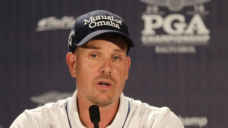 2016 British Open champion Henrik Stenson answers a question during a news conference after a practice round for the PGA Championship golf tournament at Baltusrol Golf Club in Springfield, N.J., Tuesday, July 26, 2016. (AP Photo/Chuck Burton)