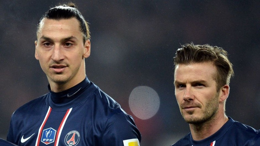 Paris Saint-Germain's Swedish forward Zlatan Ibrahimovic (L) and Paris Saint-Germain's English midfielder David Beckham (R) wait the start of the French Cup football match Paris Saint-Germain vs Marseille February 27, 2013 at the Parc des Princes stadium in Paris. AFP PHOTO/ FRANCK FIFE (Photo credit should read FRANCK FIFE/AFP/Getty Images)