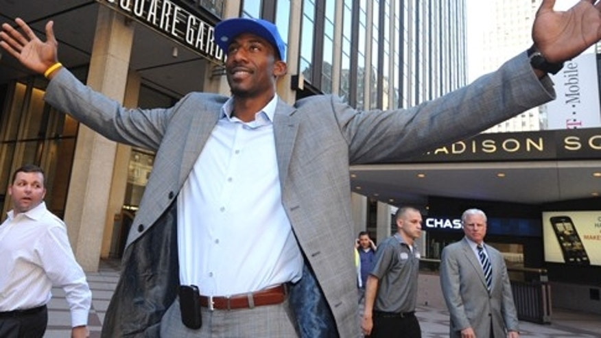 Amare Stoudemire stands outside of Madison Square Garden in 2010 after signing his contract with the Knicks.