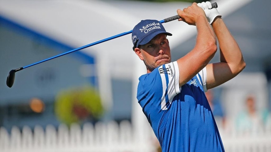 Henrik Stenson watches his tee shot on the 18th hole during a practice round for the PGA Championship golf tournament at Baltusrol Golf Club in Springfield, N.J., Wednesday, July 27, 2016. (AP Photo/Mike Groll)