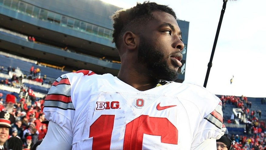 ANN ARBOR, MI - NOVEMBER 28: Quarterback J.T. Barrett #16 of the Ohio State Buckeyes after the game against the Michigan Wolverines at Michigan Stadium on November 28, 2015 in Ann Arbor, Michigan. Ohio State defeated Michigan 42-13. (Photo by Andrew Weber/Getty Images)