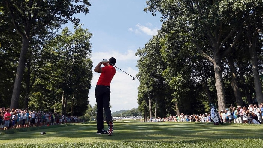 Jason Day watches his tee shot on the fifth hole during a practice round for the PGA Championship golf tournament at Baltusrol Golf Club in Springfield, N.J., Wednesday, July 27, 2016. (AP Photo/Tony Gutierrez)