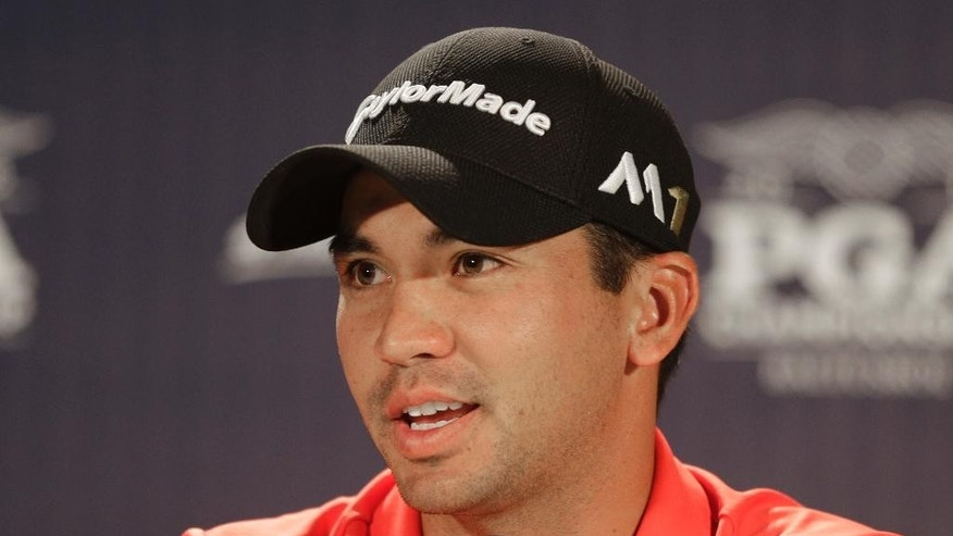 Jason Day , of Australia, answers a question during a news conference before a practice round for the PGA Championship golf tournament at Baltusrol Golf Club in Springfield, N.J., Wednesday, July 27, 2016. (AP Photo/Chuck Burton)
