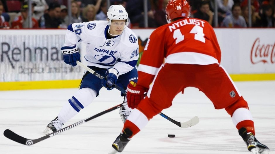 Nov 3, 2015; Detroit, MI, USA; Tampa Bay Lightning center Vladislav Namestnikov (90) skates with the puck defended by Detroit Red Wings center Gustav Nyquist (14) in the second period at Joe Louis Arena. Mandatory Credit: Rick Osentoski-USA TODAY Sports