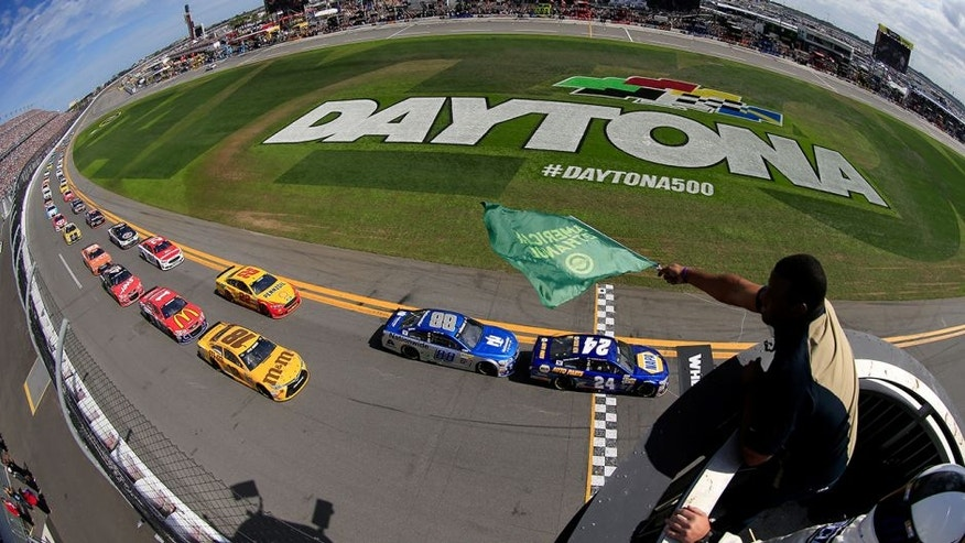 DAYTONA BEACH, FL - FEBRUARY 21: Ken Griffey Jr waves the green flag as Chase Elliott, driver of the #24 NAPA Auto Parts Chevrolet, leads the field to start the NASCAR Sprint Cup Series DAYTONA 500 at Daytona International Speedway on February 21, 2016 in Daytona Beach, Florida. (Photo by Chris Trotman/NASCAR via Getty Images)