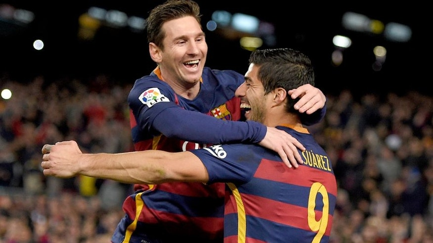 Barcelona's Uruguayan forward Luis Suarez (R) celebrates a goal with Barcelona's Argentinian forward Lionel Messi during the Spanish league football match FC Barcelona vs RC Celta de Vigo at the Camp Nou stadium in Barcelona on February 14, 2016. / AFP / LLUIS GENE (Photo credit should read LLUIS GENE/AFP/Getty Images)