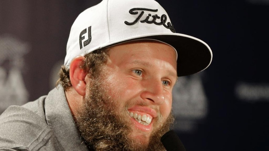 Andrew Johnston, of England, smiles as he answers a question before a practice round for the PGA Championship golf tournament at Baltusrol Golf Club in Springfield, N.J., Wednesday, July 27, 2016. (AP Photo/Chuck Burton)