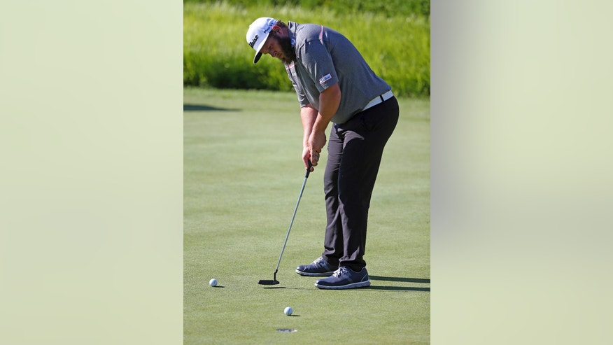 Andrew Johnston, of England, putts on the practice green before a practice round for the PGA Championship golf tournament at Baltusrol Golf Club in Springfield, N.J., Wednesday, July 27, 2016. (AP Photo/Seth Wenig)