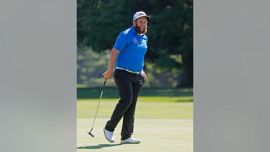Andrew Johnston, of England, smiles after a putt on the 11th hole during a practice round for the PGA Championship golf tournament at Baltusrol Golf Club in Springfield, N.J., Tuesday, July 26, 2016. (AP Photo/Tony Gutierrez)