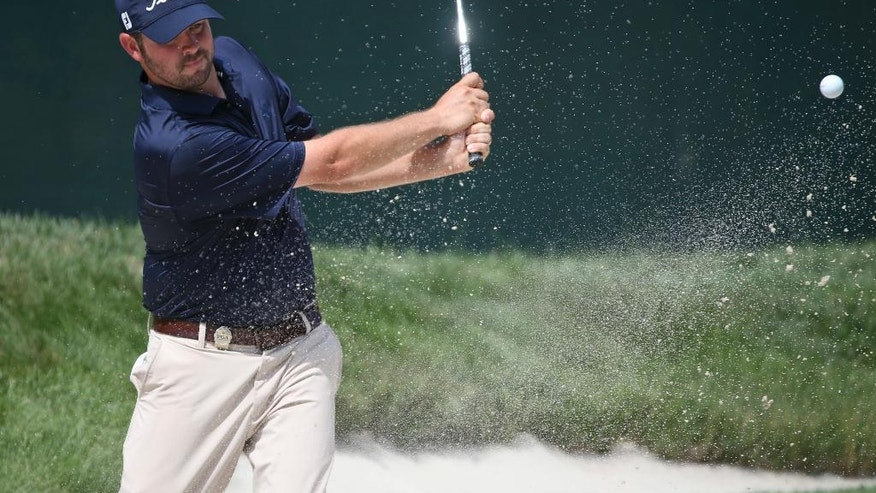 Josh Speight hits from a sand trap on the 11th hole during a practice round for the PGA Championship golf tournament at Baltusrol Golf Club in Springfield, N.J., Wednesday, July 27, 2016. (AP Photo/Seth Wenig)
