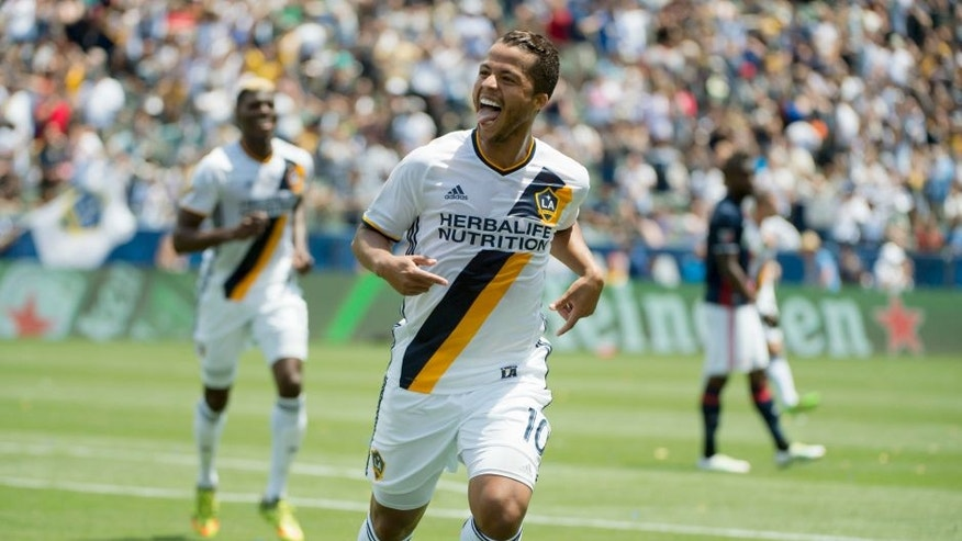 May 8, 2016; Carson, CA, USA; LA Galaxy forward Giovani dos Santos (10) celebrates after scoring a goal against the New England Revolution during the first half at StubHub Center. Mandatory Credit: Kelvin Kuo-USA TODAY Sports