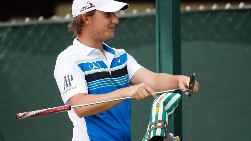 Emiliano Grillo, of Argentina, checks his putter on the 14th tee during the first round of the PGA Championship golf tournament at Baltusrol Golf Club in Springfield, N.J., Thursday, July 28, 2016. (AP Photo/Mike Groll)
