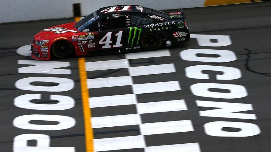"LONG POND, PA - JUNE 06: Kurt Busch, driver of the #41 Monster Energy/Haas Automation Chevrolet, crosses the finish line to win the NASCAR Sprint Cup Series Axalta ""We Paint Winners"" 400 at Pocono Raceway on June 6, 2016 in Long Pond, Pennsylvania. (Photo by Jeff Zelevansky/Getty Images)"