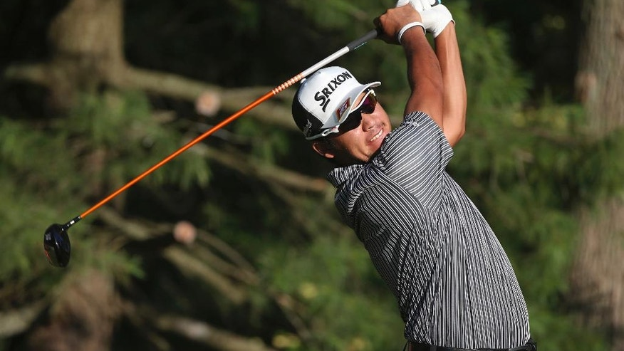 Hideki Matsuyama watches his tee shot on the 10th tee during the first round of the PGA Championship golf tournament at Baltusrol Golf Club in Springfield, N.J., Thursday, July 28, 2016. (AP Photo/Seth Wenig)