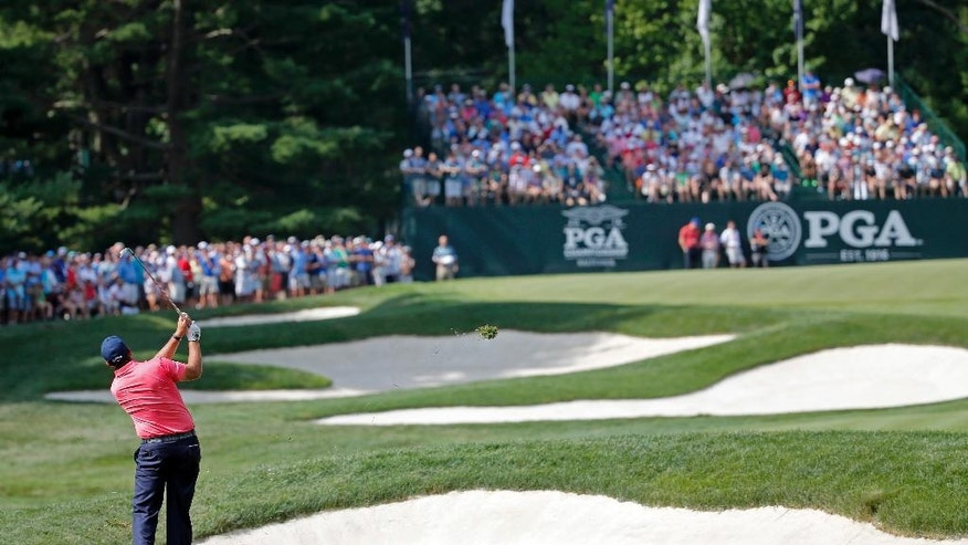 Phil Mickelson hits to the 15th green during the first round of the PGA Championship golf tournament at Baltusrol Golf Club in Springfield, N.J., Thursday, July 28, 2016. (AP Photo/Mike Groll)