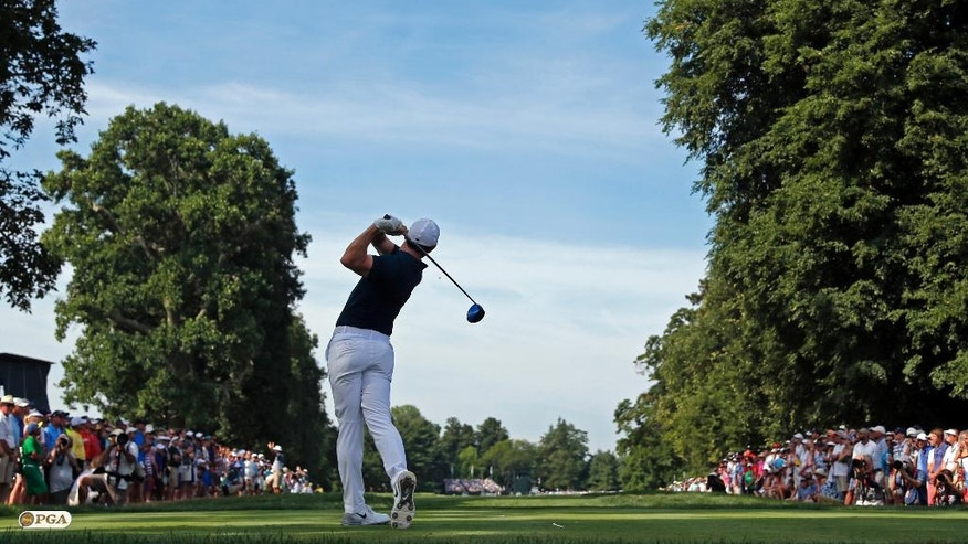 Rory McIlroy watches his tee shot on the 15th hole during the first round of the PGA Championship golf tournament at Baltusrol Golf Club in Springfield, N.J., Thursday, July 28, 2016. (AP Photo/Mike Groll)