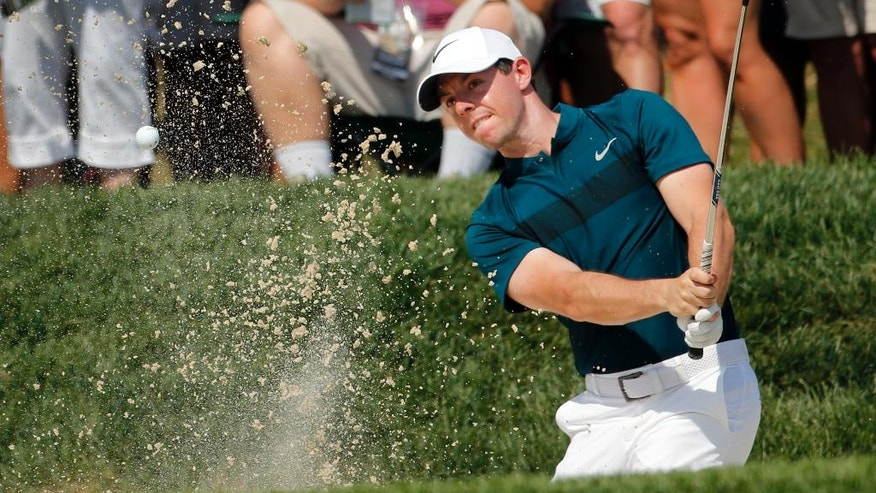 Rory McIlroy hits from a sand trap on the 16th hole during the first round of the PGA Championship golf tournament at Baltusrol Golf Club in Springfield, N.J., Thursday, July 28, 2016. (AP Photo/Mike Groll)