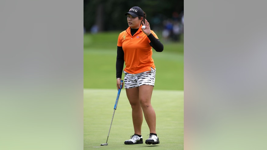 Thailand's Ariya Jutanugarn waves after her round on the 18th green during day one of the  Women's British Open at Woburn Golf Club, Woburn England Thursday July 28, 2016. (Nick Potts/PA via AP)