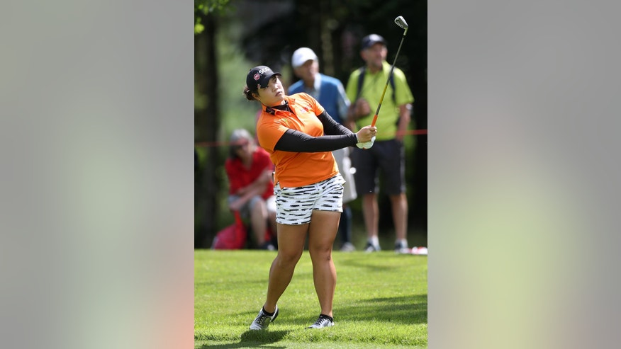 Thailand's Ariya Jutanugarn plays her second shot on the 16th hole during day one of the  Women's British Open at Woburn Golf Club, Woburn England Thursday July 28, 2016. (Nick Potts/PA via AP)
