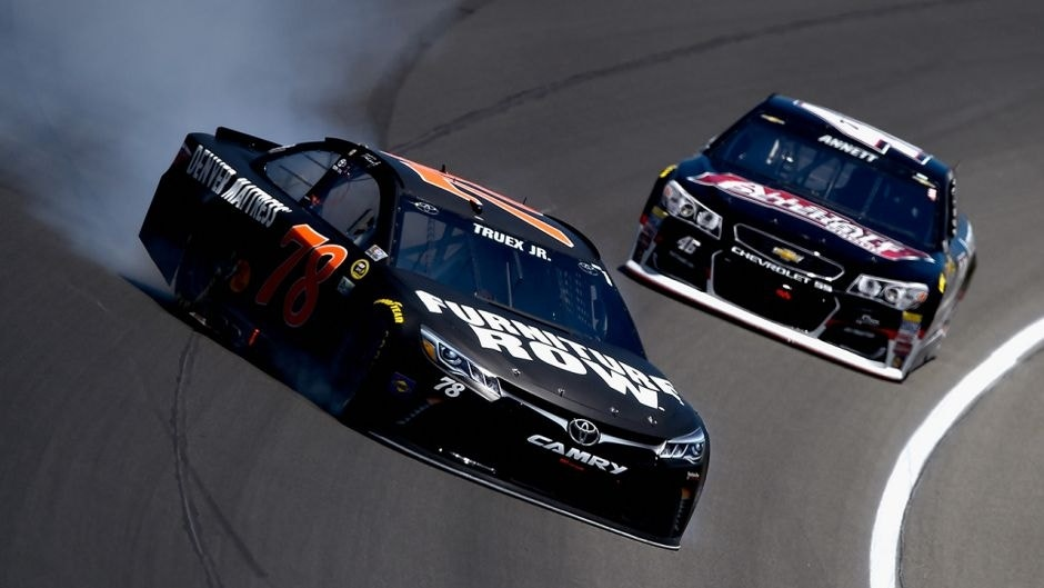 BROOKLYN, MI - JUNE 12: Martin Truex Jr, driver of the #78 Furniture Row Toyota, spins on the track in front of Michael Annett, driver of the #46 All State Peterbilt Chevrolet, during the NASCAR Sprint Cup Series FireKeepers Casino 400 at Michigan International Speedway on June 12, 2016 in Brooklyn, Michigan. (Photo by Josh Hedges/Getty Images )