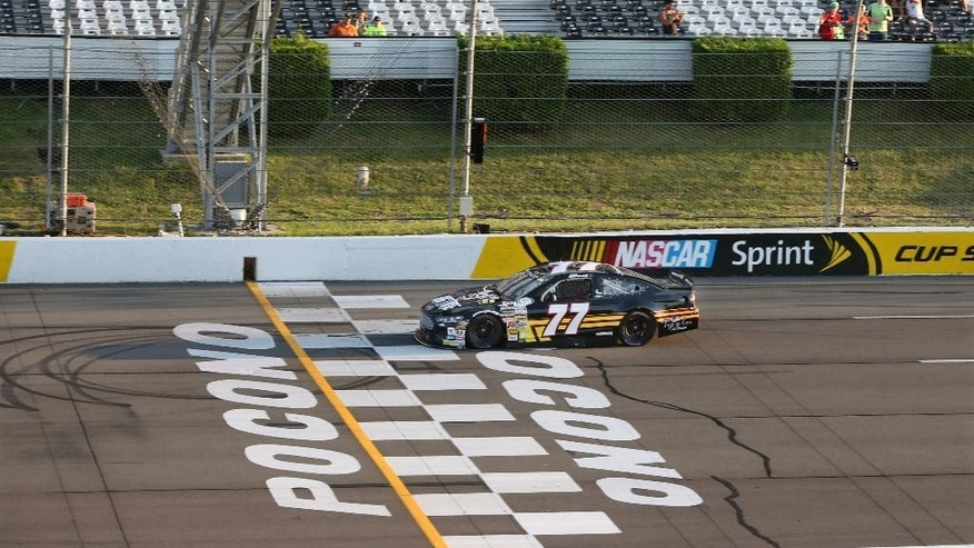 Chase Briscoe takes the checkered flag to win the ARCA Series  auto race at Pocono Raceway on Friday, July 29, 2016, in Long Pond, Pa. (AP Photo/Mel Evans)