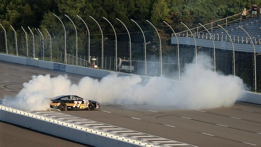 Chase Briscoe (celebrates with a burnout after winning the ARCA Series auto race at Pocono Raceway on Friday, July 29, 2016, in Long Pond, Pa. (AP Photo/Mel Evans)