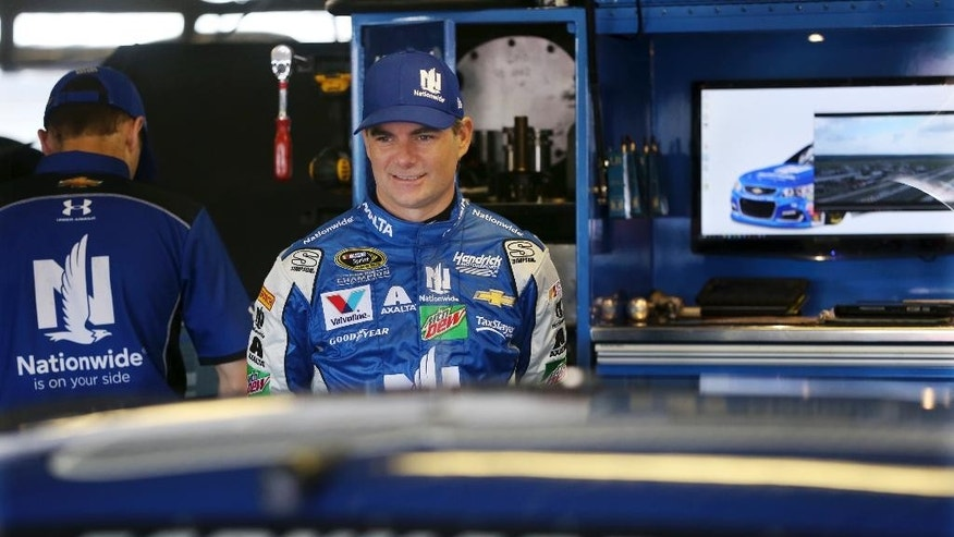Jeff Gordon (88) stands in the garage area at Pocono Raceway during practice for Sunday's NASCAR Sprint Cup Series Pennsylvania 400 auto race Sunday Friday, July 29, 2016, in Long Pond, Pa. Gordon came out of retirement to fill in for the injured Dale Earnhardt Jr. (AP Photo/Mel Evans)