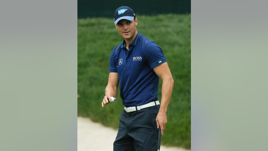 Martin Kaymer smiles after his birdie putt on the fourth hole during the second round of the PGA Championship golf tournament at Baltusrol Golf Club in Springfield, N.J., Friday, July 29, 2016. (AP Photo/Tony Gutierrez)
