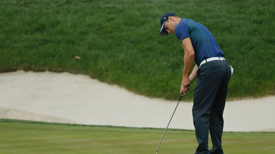Martin Kaymer putts on the fourth hole during the second round of the PGA Championship golf tournament at Baltusrol Golf Club in Springfield, N.J., Friday, July 29, 2016. (AP Photo/Tony Gutierrez)
