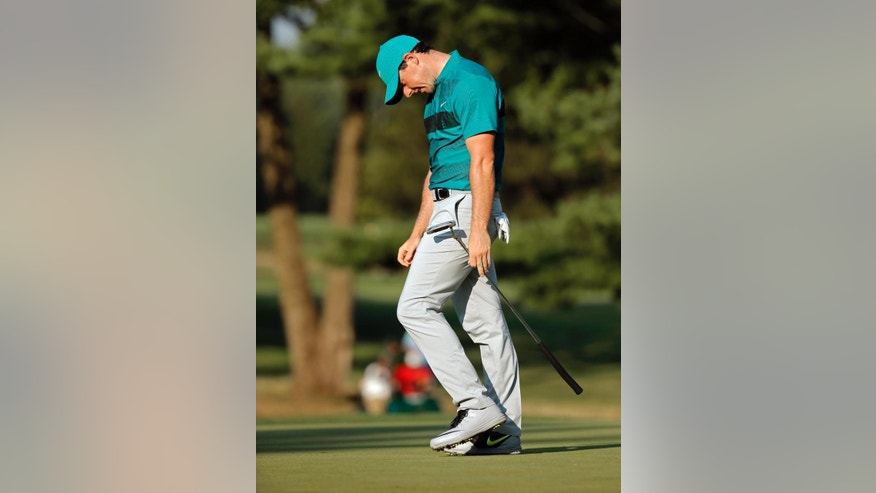Rory McIlroy reacts to missing a putt on the 15th hole during the second round of the PGA Championship golf tournament at Baltusrol Golf Club in Springfield, N.J., Friday, July 29, 2016. (AP Photo/Mike Groll)