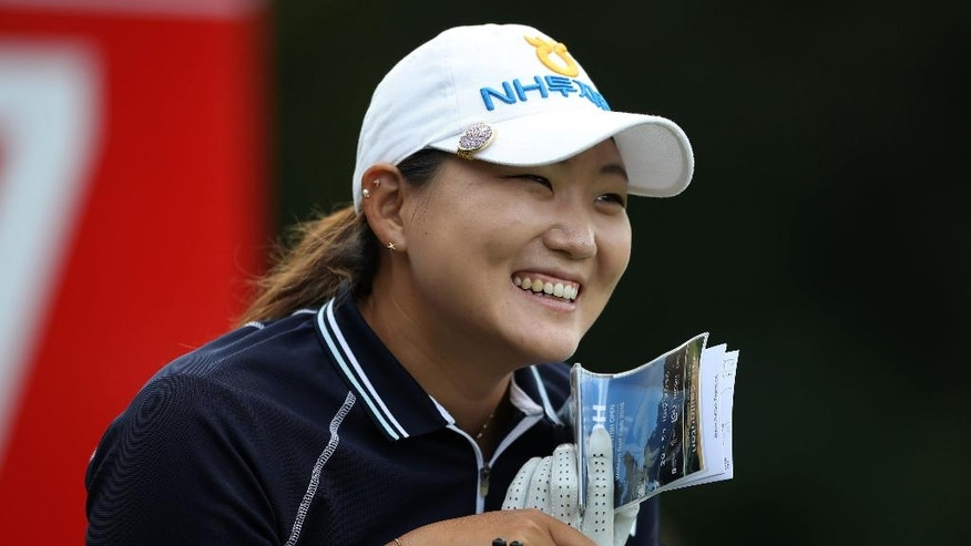South Korea's Mirim Lee reacts during the second round of the Women's British Open at Woburn Golf Club, in Woburn, England, Friday July 29, 2016. (Nick Potts/PA via AP)